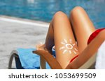 young woman with sun shape on... | Shutterstock . vector #1053699509