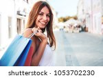 woman in shopping. happy woman... | Shutterstock . vector #1053702230
