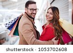 beautiful young couple enjoying ... | Shutterstock . vector #1053702608