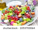fresh and healthy salad made... | Shutterstock . vector #1053703064