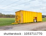 large yellow cow manure tank...