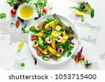 fresh avocado  shrimps  mango... | Shutterstock . vector #1053715400