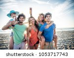 multicultural group of friends... | Shutterstock . vector #1053717743