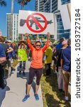 Small photo of Sarasota, FL/US -March 24, 2018 - Protesters gather at the student-led protest March For Our Lives demanding government action on gun control following the mass shooting in Parkland, Florida.
