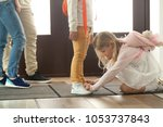 sister helping brother to tie...   Shutterstock . vector #1053737843