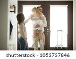 happy father hugging little... | Shutterstock . vector #1053737846