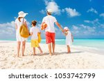 back view of a happy family... | Shutterstock . vector #1053742799