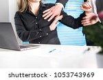 assistant defending herself... | Shutterstock . vector #1053743969