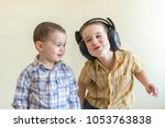 a little boy with his... | Shutterstock . vector #1053763838