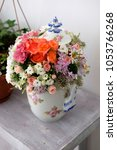 Small photo of Flowers arrangement. Flowers arrangement for special events in a pottery bowl.