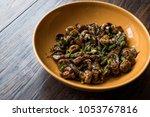homemade cultivated mushroom... | Shutterstock . vector #1053767816