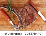 meat food   roast rib on wooden ...
