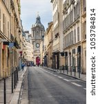 cozy street in paris  france.... | Shutterstock . vector #1053784814