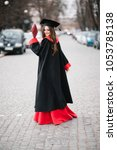 Small photo of Beautiful happy graduate, graduated student girl, young woman in cap gown turning smiling holding diploma Celebrating graduation ceremony
