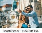 portrait of loving couple... | Shutterstock . vector #1053785156
