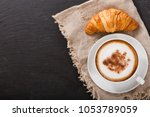 cup of cappuccino coffee and... | Shutterstock . vector #1053789059