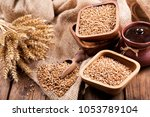 grains and wheat ears on a... | Shutterstock . vector #1053789104