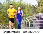 sporty people running during... | Shutterstock . vector #1053820970