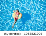 woman sunbathing on yellow... | Shutterstock . vector #1053821006