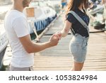 lovers  boy and girl  walk on a ... | Shutterstock . vector #1053824984