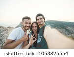 a group of happy friends are... | Shutterstock . vector #1053825554