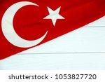 turkish flag on white wooden... | Shutterstock . vector #1053827720