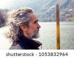 mature man practicing tai chi... | Shutterstock . vector #1053832964