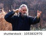 mature man practicing tai chi... | Shutterstock . vector #1053832970