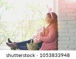 easter eggs girl sitting on...   Shutterstock . vector #1053833948