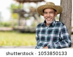 portrait happy mature man is... | Shutterstock . vector #1053850133