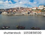 ribeira  old town of porto and... | Shutterstock . vector #1053858530