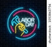 glowing neon labor day sign in...   Shutterstock .eps vector #1053863756