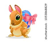 easter bunny with the egg.... | Shutterstock .eps vector #1053868829