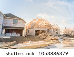 blurred wood frame house under... | Shutterstock . vector #1053886379