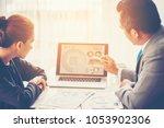business adviser analyzing... | Shutterstock . vector #1053902306