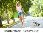 Stock photo portrait of happy female strolling with her pet at leisure 105391319