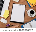 clipboard on desk | Shutterstock . vector #1053918620