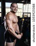 brutal strong bodybuilder... | Shutterstock . vector #1053925388