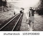 woman is waiting for a steam... | Shutterstock . vector #1053930800