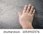 the blind kid's hand and... | Shutterstock . vector #1053932576