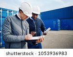 two engineers standing by... | Shutterstock . vector #1053936983