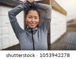 young asian woman in running... | Shutterstock . vector #1053942278