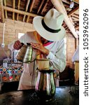 a colombian barista preparing a ... | Shutterstock . vector #1053962096