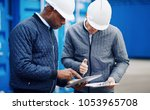 two engineers tracking... | Shutterstock . vector #1053965708