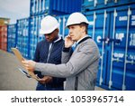 engineer talking on a cellphone ... | Shutterstock . vector #1053965714