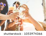 group of happy friends cheering ... | Shutterstock . vector #1053974366