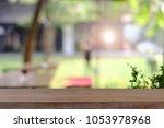 empty wooden table platform... | Shutterstock . vector #1053978968