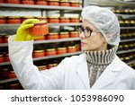 serious seafood expert in... | Shutterstock . vector #1053986090