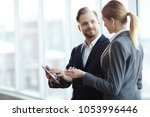 young analysts or brokers... | Shutterstock . vector #1053996446