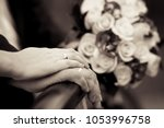 the bride's hand lies on the... | Shutterstock . vector #1053996758